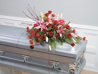 Red roses and stargazer lily casket spray